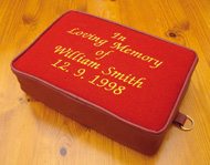 An 'In memory' embroidered kneeler cushion