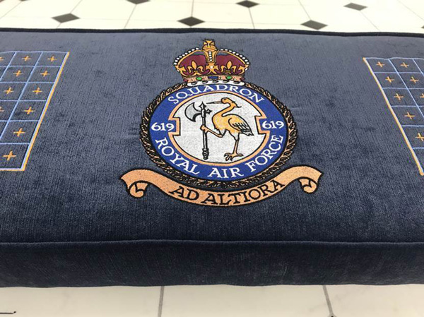 A detail showing the bespoke embroidered emblem of the Royal Air Forces 619 Squadron on the kneeler cushion