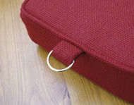 A church kneeler cushion with 'D-ring' fitted